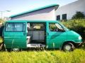 BulliHoliday VW California mieten Helga - Seitenansicht mit aufgestelltem Aufstelldach