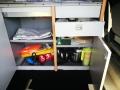 BulliHoliday VW California mieten Helga - geöffnete Schranktüren und Schubladen
